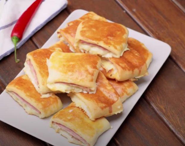 Panini farciti con prosciutto e formaggio: la ricetta dei mini panini morbidi e filanti