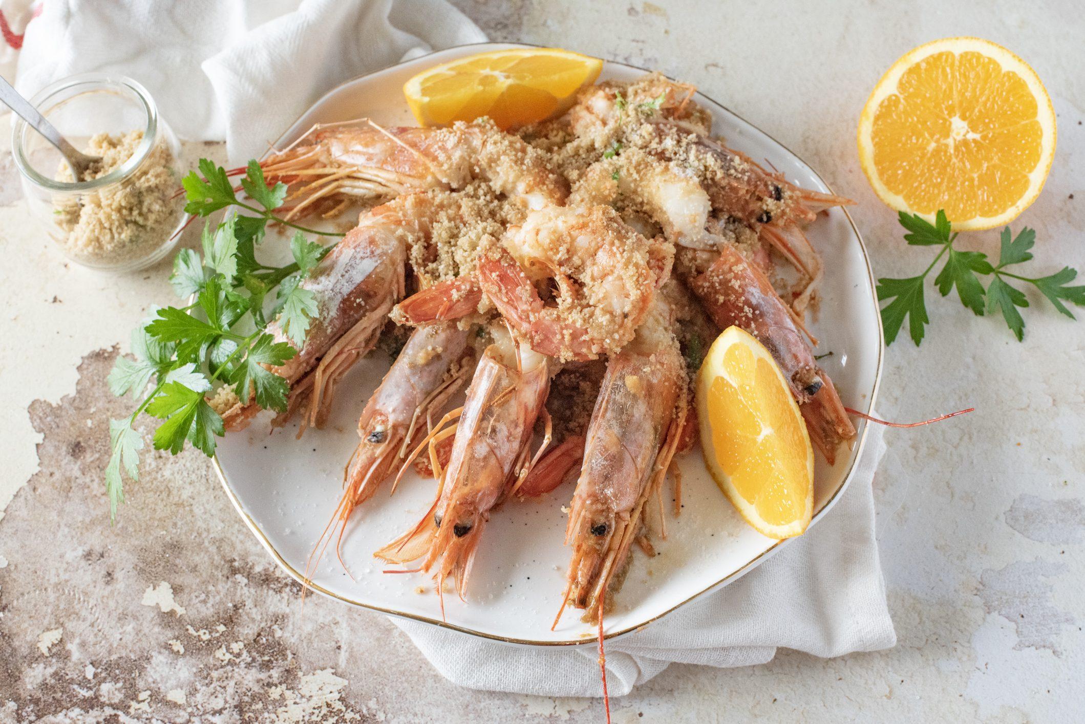 Gamberoni in teglia gratinati: la ricetta del piatto ideale per una cena speciale
