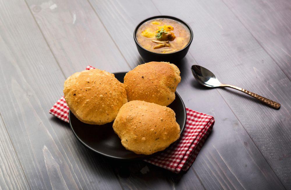 Poori: la ricetta dei paninetti indiani gonfi, ariosi e senza lievito